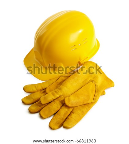 yellow hardhat and working gloves isolated on white background, selective focus - stock photo