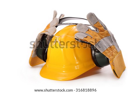 Yellow hardhat, goggles, headphones against noise and gloves on a white background - stock photo