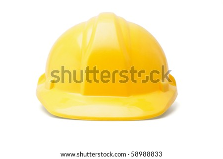 Yellow hardhat safety helmet on white background - stock photo