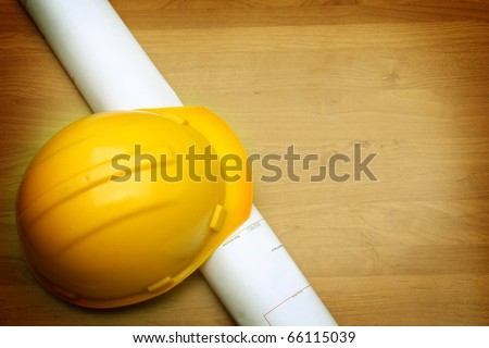 yellow helmet and paper roll