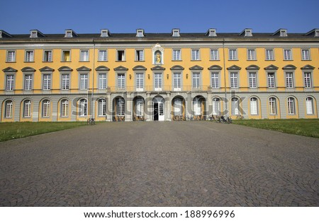 Yellow historic building of Bonn University in Bonn, Germany - stock photo