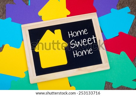 Yellow home sign on the blackboard: Home Sweet Home - stock photo