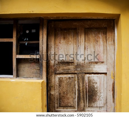 Yellow House Door and Window Peru - stock photo