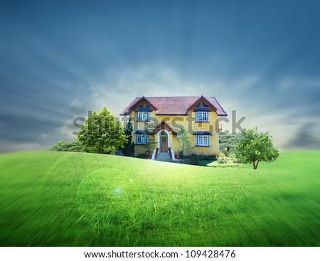 Yellow house on the prairie - stock photo