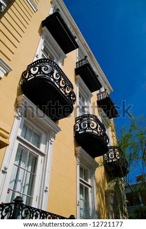 Yellow House With Balconies in Charleston, SC - stock photo