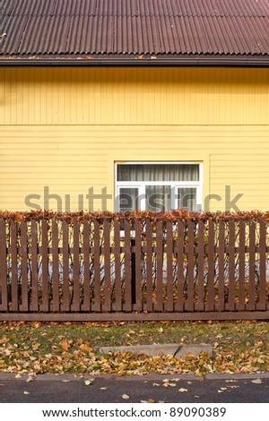 Yellow house with fence
