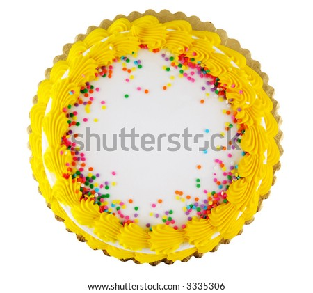 Yellow icing on a white party cake with confetti candy - stock photo