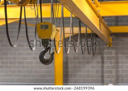 Yellow Indoor Crane's Hook and Black Sling  - stock photo