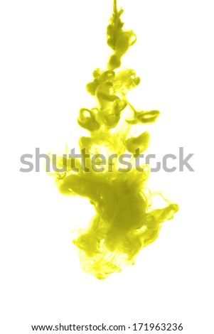 Yellow ink dropped into water isolated on white