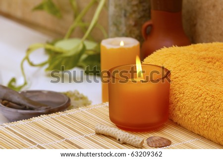 yellow items for spa in interior of home bathroom - stock photo