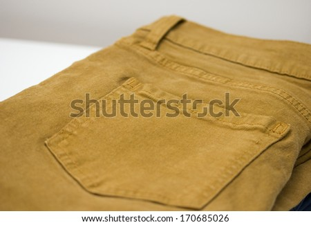 yellow jeans back pocket - stock photo