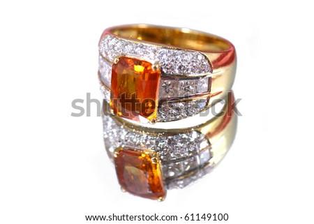 Yellow jewelry on white background - stock photo
