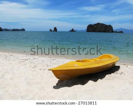 Yellow kayak on the famous Tanjung Rhu beach of Langkawi, Malaysia - stock photo