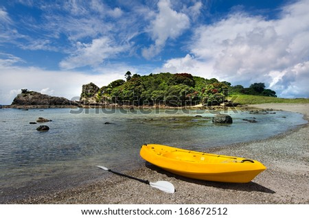 Yellow Kayak on the shore of Roberton Island lagoon at the bay of Islands, New Zealand.Very popular travel destination of NZ - stock photo