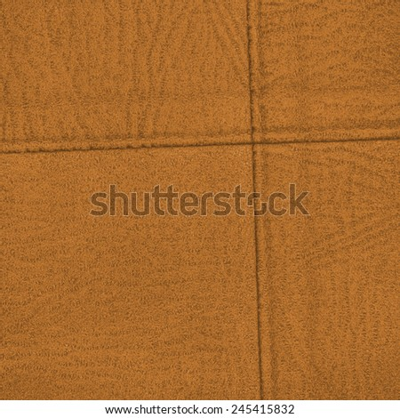 yellow  leather background decorated with seams. Useful for design-works