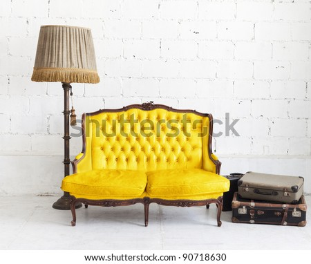 yellow leather sofa in white room - stock photo