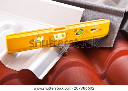Yellow level, screw, polycarbonate roof different configurations and colors - stock photo