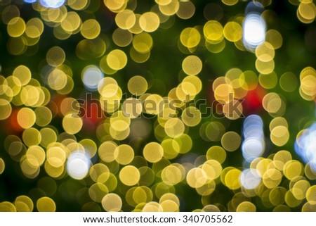 Yellow light bokeh from christmas tree. - stock photo