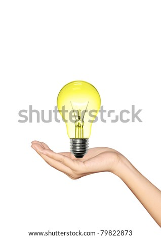 Yellow Light bulb in hand woman on white background