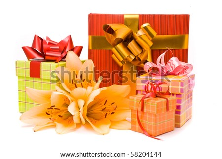 Yellow lilies and gift boxes on a white background