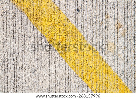 yellow line on abstract cement texture background
