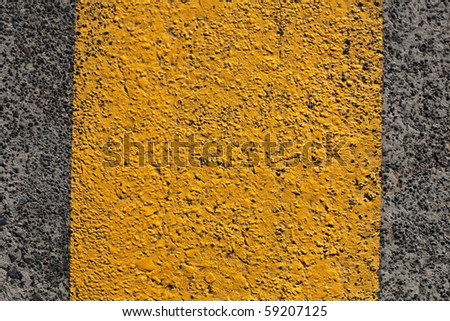 Yellow line on grey asphalt.