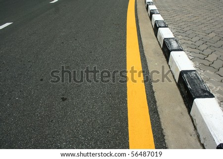 yellow line on traffice surface - stock photo