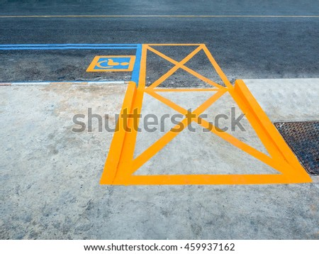 Yellow line symbol for disable parking road sign marking on tarmac