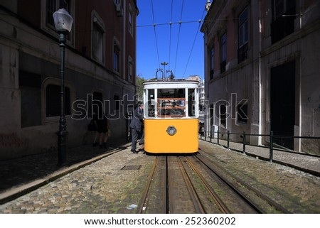 Yellow Lisbon tram, Portugal - stock photo