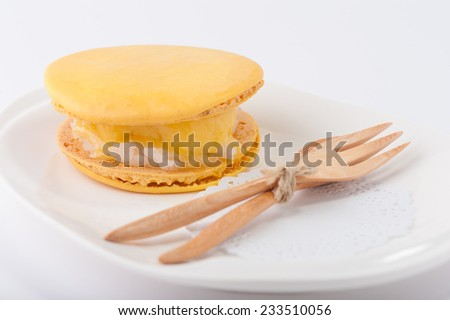 Yellow macaroon shell sandwich with ice cream and sticky rice