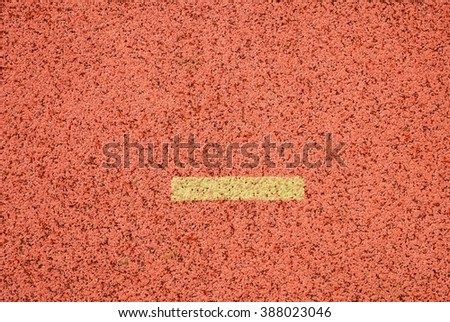 Yellow marks. White lines and texture of running racetrack, red rubber racetracks in outdoor stadium - stock photo