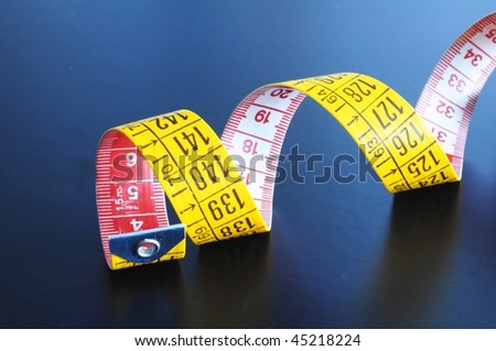 yellow measuring with copyspace on a dark background