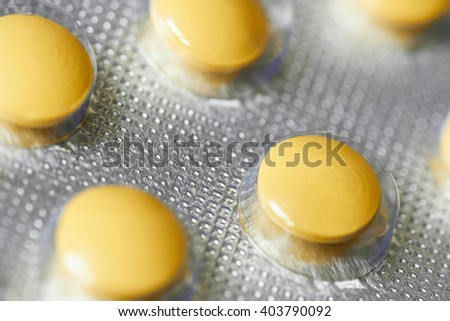 Yellow medical pills in blister pack