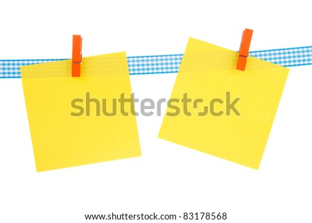 Yellow memo papers hanging with clothes pins