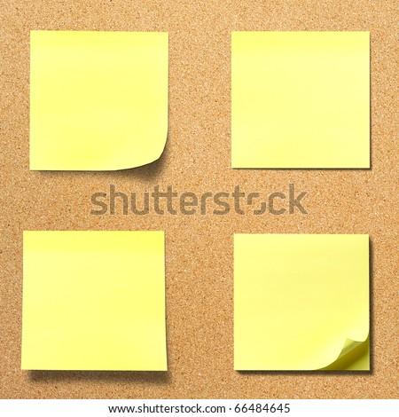 Yellow memo stick on cork board background - stock photo