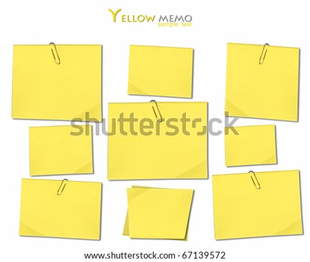 Yellow memo stick with paper clip isolated on white background - stock photo