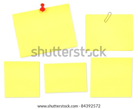 Yellow memo stick with paper clip on white background