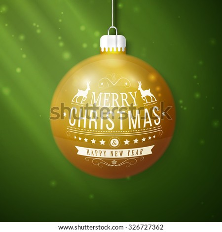 yellow merry christmas ball isolated on green background - stock photo