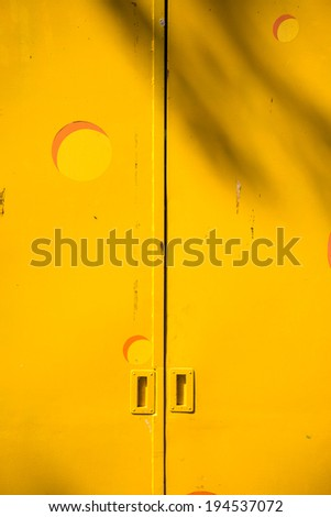 Yellow metal door