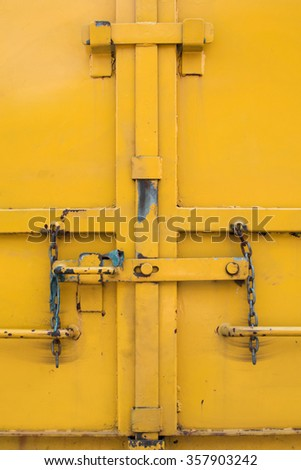 yellow metal dorr with chain lock - stock photo