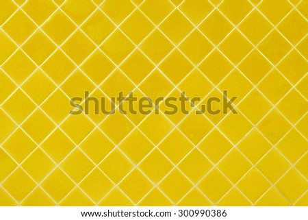 yellow mosaic tiles texture with white filling - stock photo