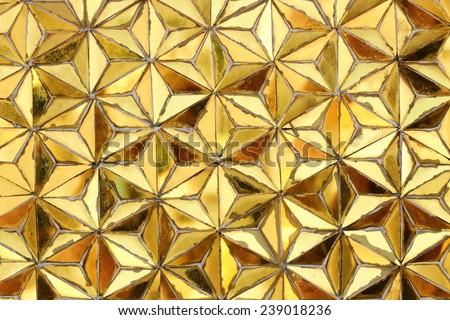 Yellow mosaic wall. - stock photo