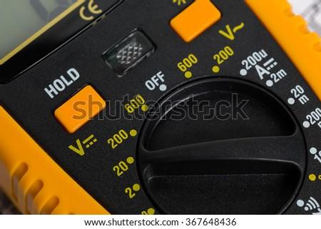 Yellow multimeter close up - stock photo