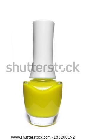 yellow nail polish bottle on white background - stock photo