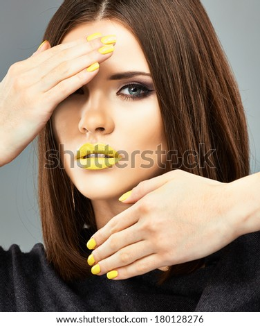 Yellow nails and lips. Beauty woman portrait