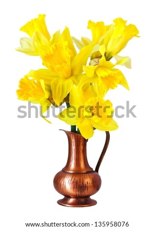 yellow narcissus flowers in a vintage jug on a white background - stock photo