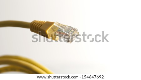 Yellow network category 5 cable (Cat 5) is a twisted pair cable for carrying signals. This type of cable is used in structured cabling for computer networks such as Ethernet. / With RJ45 connector - stock photo