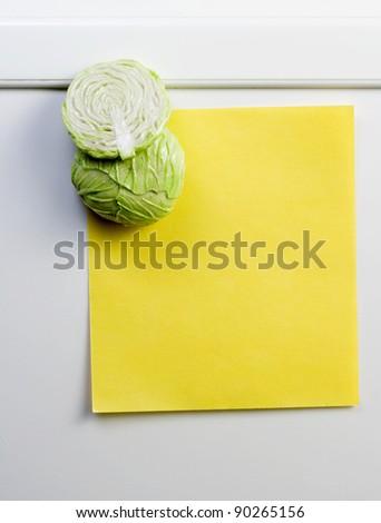 Yellow note on fridge - stock photo