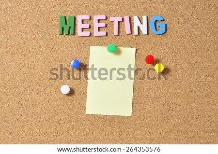 """Yellow Notepad With Alphabets """"MEETING"""" On Board Background - stock photo"""