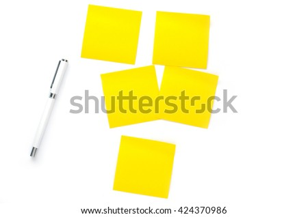 yellow notes paper and pen on white background - stock photo